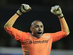 Tottenham goalkeeper Heurelho Gomes shut out AC Milan as Spurs advanced to the Champions League quarterfinals.
