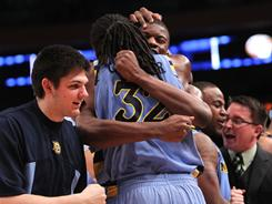 Marquette's Jae Crowder (32) celebrates with teammates after defeating the West Virginia in the second round of the 2011 Big East tournament. They play Louisville on Thursday.