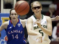 Baylor's Melissa Jones passes the ball in a Big 12 tournament on Wednesday in Kansas City, Mo. Jones is wearing sunglasses to protect a damaged right eye. 