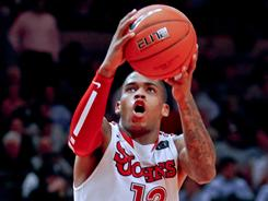 Dwight Hardy had 17 points to lead No. 18 St. John's past Rutgers in the second round of the Big East tournament.
