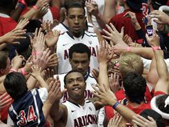 Arizona, ranked No. 15 in the USA TODAY/ESPN Coaches Poll, awaits its NCAA tournament bracket slot. 