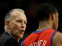 "Sixers coach Doug Collins talks to rookie Evan Turner during a December game. ""He yells at you, he disciplines you and, at the same time, he loves you,"" point guard Jrue Holiday says. ""There's times when he's going to get mad at you, but that's only to make you better."""