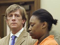 Shanterrica Madden stands with her attorney, Joe Brandon, Jr., during her arraignment in Murfreesboro, Tenn., last week.