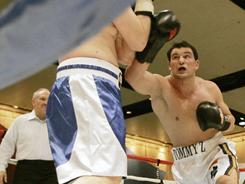 Tom Zbikowski throws a punch on Ryan St. Germain during a three-round exhibition bout in South Bend, Ind., in March 2007.