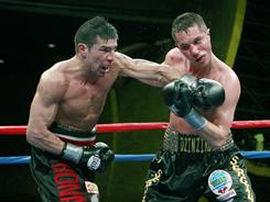 Sergio Martinez, left, knocked down Sergiy Dzinziruk five times in their bout and notched a TKO victory.