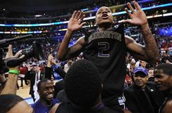 Washington Huskies guard Isaiah Thomas celebrates after making the game-winning shot in overtime of the Pac-10 tournament championship game against Arizona in Los Angeles.