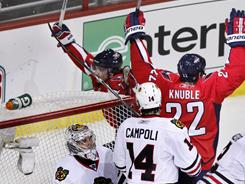 Washington Capitals winger Mike Knuble celebrates his overtime winner against the defending champion Chicago Blackhawks.