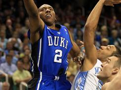 Duke guard Nolan Smith drives to the basket against the defense of North Carolina's Kendall Marshall.
