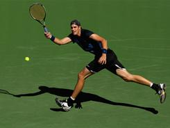 John Isner, playing a running forehand, dispatched Brazil's Ricardo Mello 6-3, 7-6 (7-2) and will meet fellow American Andy Roddick in the third round.