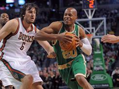Boston's Ray Allen, running past Milwaukee's Andrew Bogut during Sunday's game, led the Celtics with 17 points in their 87-56 thumping of the Bucks.