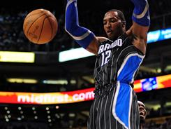 Orlando's Dwight Howard topped 10,000 career points in the third quarter of the Magic's 111-88 blowout win over the Phoenix Suns on Sunday.