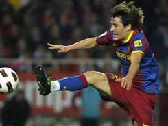 Barcelona's Bojan Krkic Perez scored the club's only goal in a 1-1 draw with Sevilla on Sunday. Barcelona's advantage in the standings over Real Madrid was cut to five points.