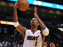 Chris Bosh dominated the paint against Tim Duncan and the Spurs, leading the Heat with 30 points and pulling down 13 rebounds.