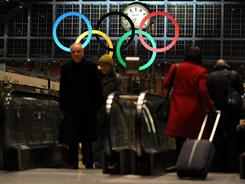 Olympic rings hang at the St. Pancras International station in London, where residents seem more concerned with the economy than the 2012 Games.