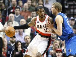 LaMarcus Aldridge, left, had 30 points and outdueled Dirk Nowitzki, right, in the Blazers' win over the Mavericks.