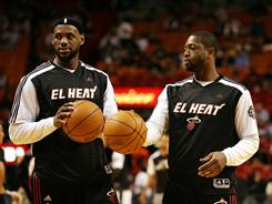 LeBron James, left, and Dwyane Wade, warming up before Monday's game against the Spurs, have helped the Heat rout their past two opponents.