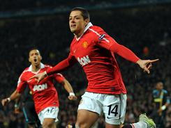 Manchester United's Javier Hernandez's brace sent the Reds through to the quarterfinals after defeating Marseille 2-1 at Old Trafford on Tuesday. Hernandez scored on a pair of simple tap-ins, courtesy of Wayne Rooney and Ryan Giggs.