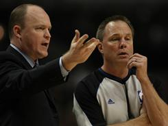 NBA referee Bill Spooner, right, conversing with Milwaukee Bucks head coach Scott Skiles during a Dec. 28 game, is suing an Associated Press reporter over Tweets that implied that Spooner was engaged in fixing a game.