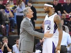 Kings coach Paul Westphal, left, leads a young, improving team that includes rookie forward DeMarcus Cousins, right.