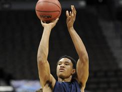 Richmond's Justin Harper shoots during practice March 16 in Denver.