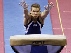 Jonathan Horton leaps onto the vault during the men's competition at the U.S. gymnastics championships in Dallas in Aug. 2009.