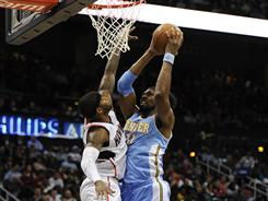 Nene, right, had a team-high 20 points as the Nuggets earned their ninth win in 11 games since trading Carmelo Anthony.