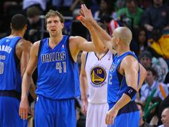 Dirk Nowitzki (41) had 34 points to lead the Mavericks' furious rally from an 18-point deficit.