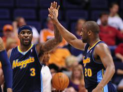Former UNC stars Ty Lawson (3) and Raymond Felton (20) are splitting time at point guard for the Nuggets.