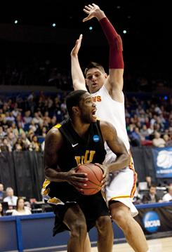 Virginia Commonwealth Rams forward Jamie Skeen (21) tries to get clear of Southern California Trojans forward Nikola Vucevic during their NCAA tournament game in Dayton, Ohio.