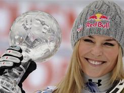 Winning the World Cup downhill title brings a smile to Colorado's Lindsey Vonn, who also moved into first place in her bid for a fourth consecutive overall championship.