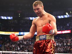 Lucian Bute celebrates after his fourth-round TKO agtainst Fulgencio Zuniga in 2009.
