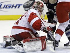 Joey MacDonald blanked the Blue Jackets on the road, stopping 37 shots to keep the Red Wings in contention for the top seed in the Western Conference.