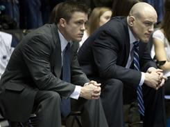 Penn State coach Cael Sanderson, right, and his brother and assistant coach Cody Sanderson, have designs on breaking the hold Iowa and Oklahoma State have on the NCAA team title.