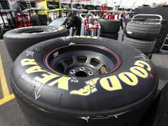 Cords show through on a tire with excessive wear from a practice Friday at Bristol Motor Speedway. NASCAR and Goodyear are bringing in new right-side tires for races Saturday and Sunday.