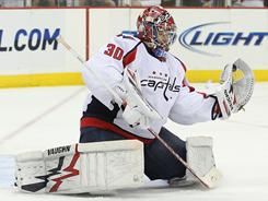 Capitals rookie goalie Michael Neuvirth makes one of his 33 saves in his fourth shutout of the season.