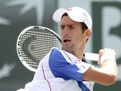 Novak Djokovic of Serbia follows through on a forehand during his victory against Richard Gasquet of France in the BNP Paribas Open on Friday in Indian Wells, Calif.