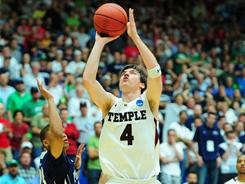 Juan Fernandez (4) hit the game-winning shot against Penn State in the second round of the NCAA tournament.