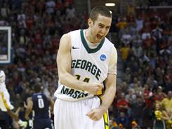 Luke Hancock's crucial three-pointer with 21 seconds left helped George Mason win its first NCAA tournament game since its Cinderella run to the Final Four in 2006.