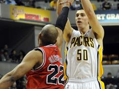 Tyler Hansbrough, seen here shooting over Chicago's Taj Gibson during Friday's game, led the Pacers with 29 points and 12 rebounds during their 115-108 win over the Bulls.