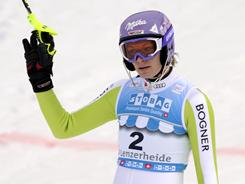 Germany's Maria Riesch retook the overall World Cup lead after placing fourth during Friday's slalom in Lenzerheide, Switzerland.