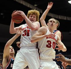 Wisconsin's Mike Bruesewitz pulls down a rebound against the Belmont's Bruins during the Badgers' second-round victory in Tucson, Ariz.