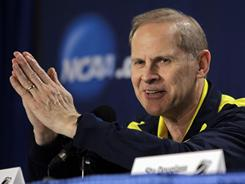 Michigan coach John Beilein answers a question during a news conference for the West regional NCAA tournament  game in Charlotte, N.C.