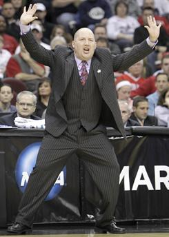 Marquette head coach Buzz Williams and the Golden Eagles play Big East foe Syracuse Sunday in Cleveland.