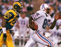 In this 1986 file photo, Houston Oilers wide receiver Drew Hill breaks away from Los Angeles Rams' Vince Newsome to score a 61-yard touchdown. An Atlanta hospital spokesman says Hill died Saturday, March 19, 2011 at 54 years old.