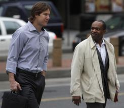 Cleveland Browns linebacker Scott Fujita, left, and NFL Players Association chief DeMaurice Smith walk to an NFL/NFLPA mediation session Feb. 21 in Washington.