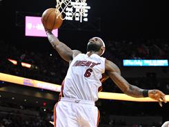 LeBron James (6) dunks home two of his game-high 33 points in the Heat's win over the Nuggets.