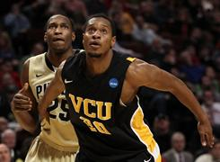 VCU's Bradford Burgess boxes out Purdue's JaJuan Johnson during VCU's third-round upset victory in Chicago.
