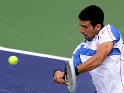Novak Djokovic of Serbia fires a backhand during his victory Sunday against Rafael Nadal in the final of the BNP Paribas Open in Indian Wells, Calif.