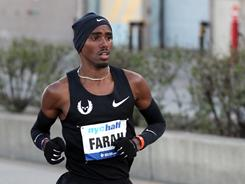 In this photo provided by the New York Road Runners, Mo Farah competes in the NYC Half-Marathon on March 20.