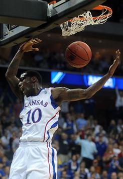 Kansas Jayhawks guard Tyshawn Taylor throws down two of his 13 points during their third-round victory over Illinois in Tulsa.